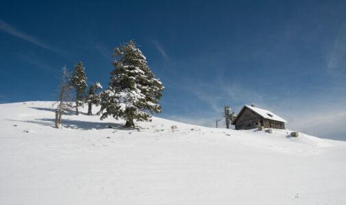 Mountain hut in snow